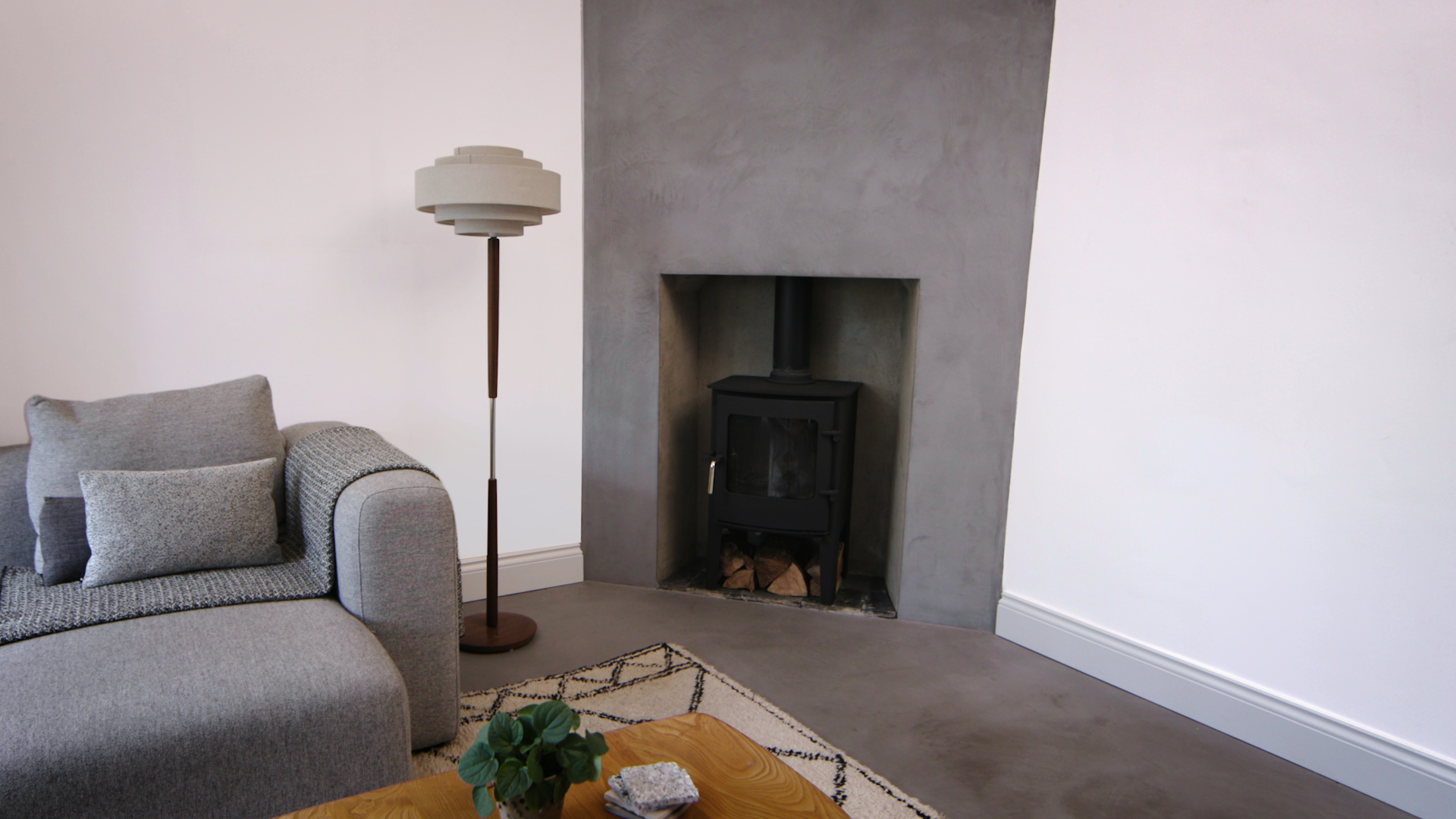grey and white wall with fireplace