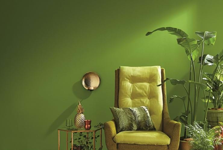 Living room with green walls and arm chair