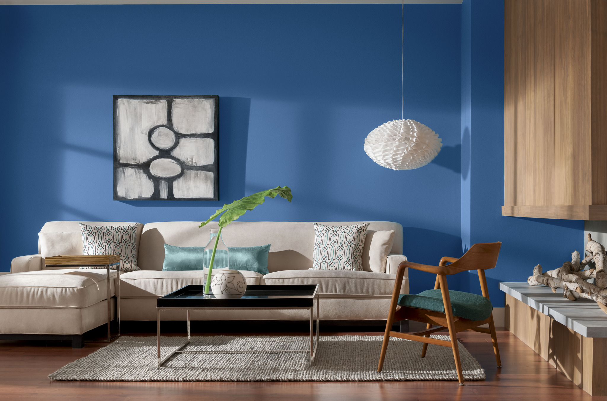 Living Room With Blue Painted Walls And Beige Sofa